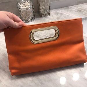 Charming Charlie Orange Clutch